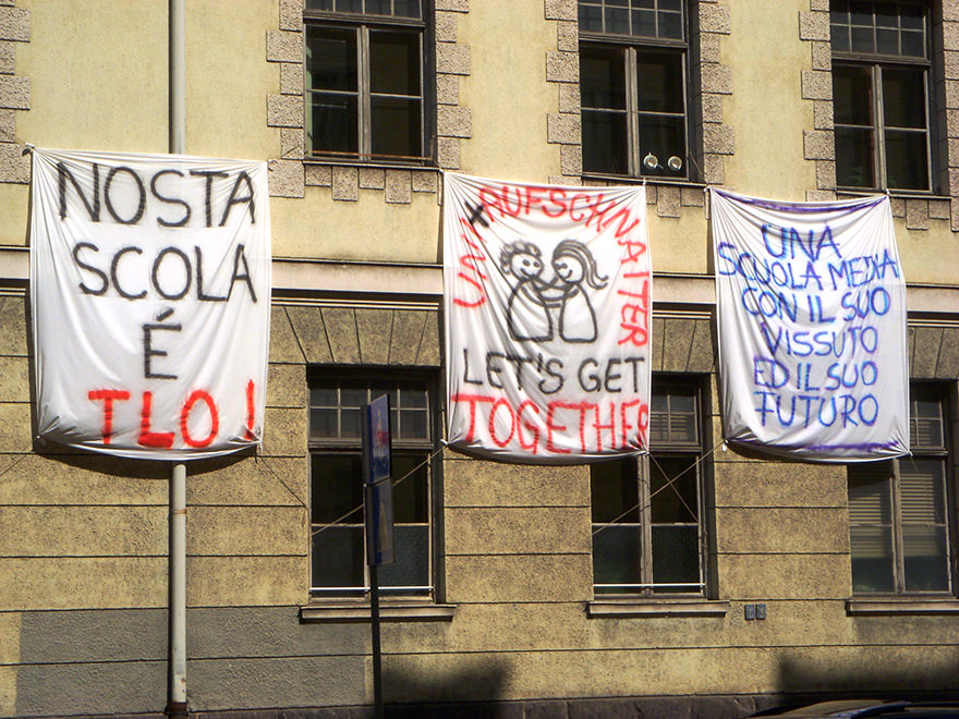 Protest signs outside school in Bozen-Bolzano, Italy
